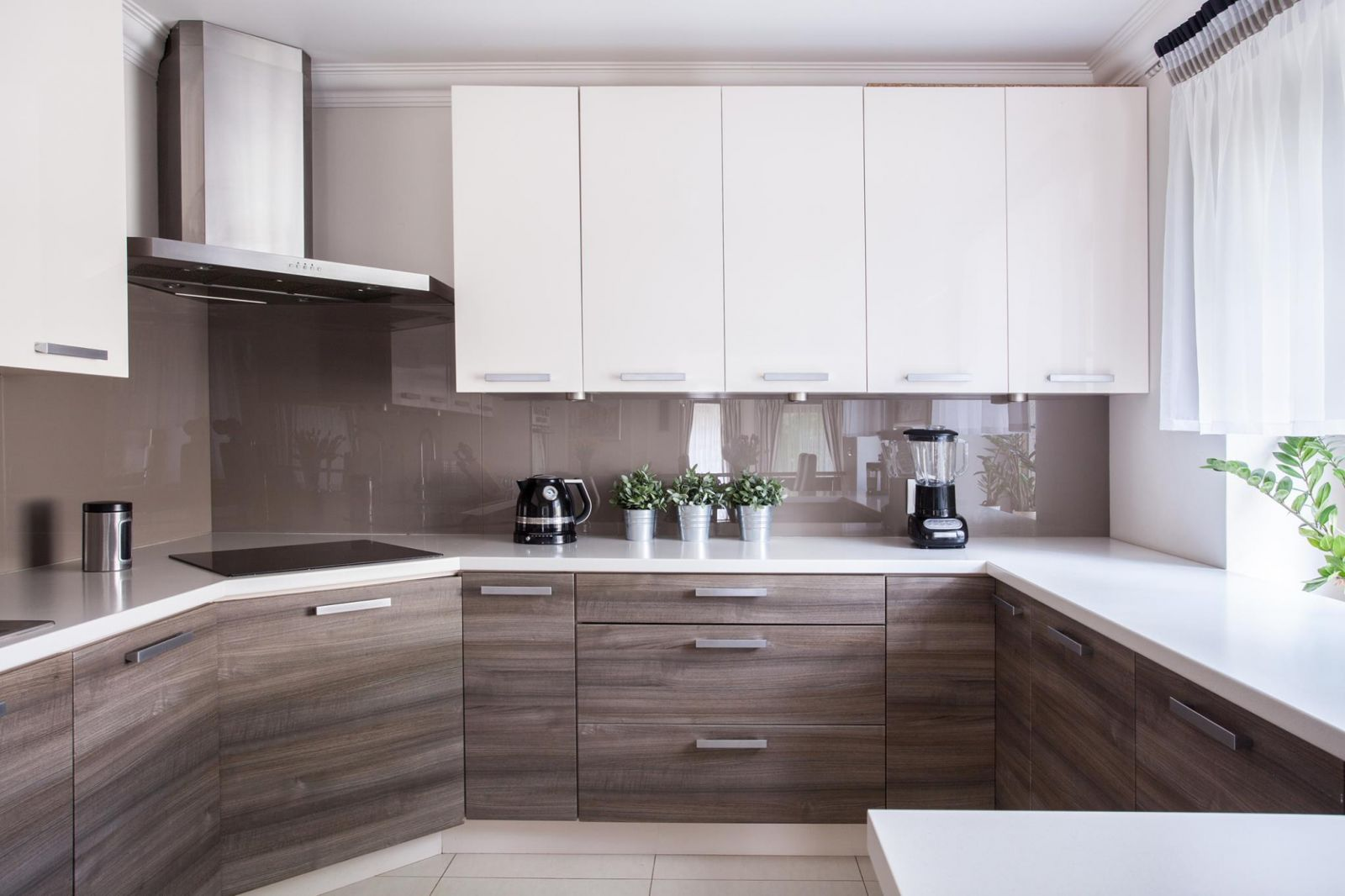 A beautiful custom remodeled kitchen with white cabinets by Tom Watson Construction