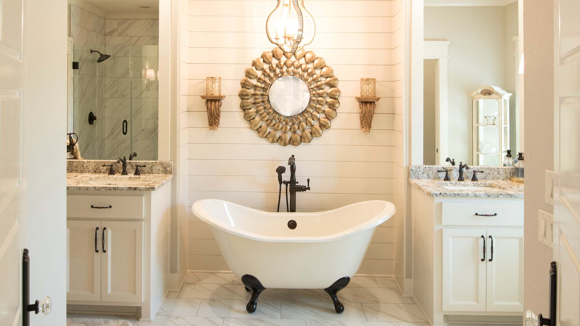 A beautiful bathroom with white and gold accents