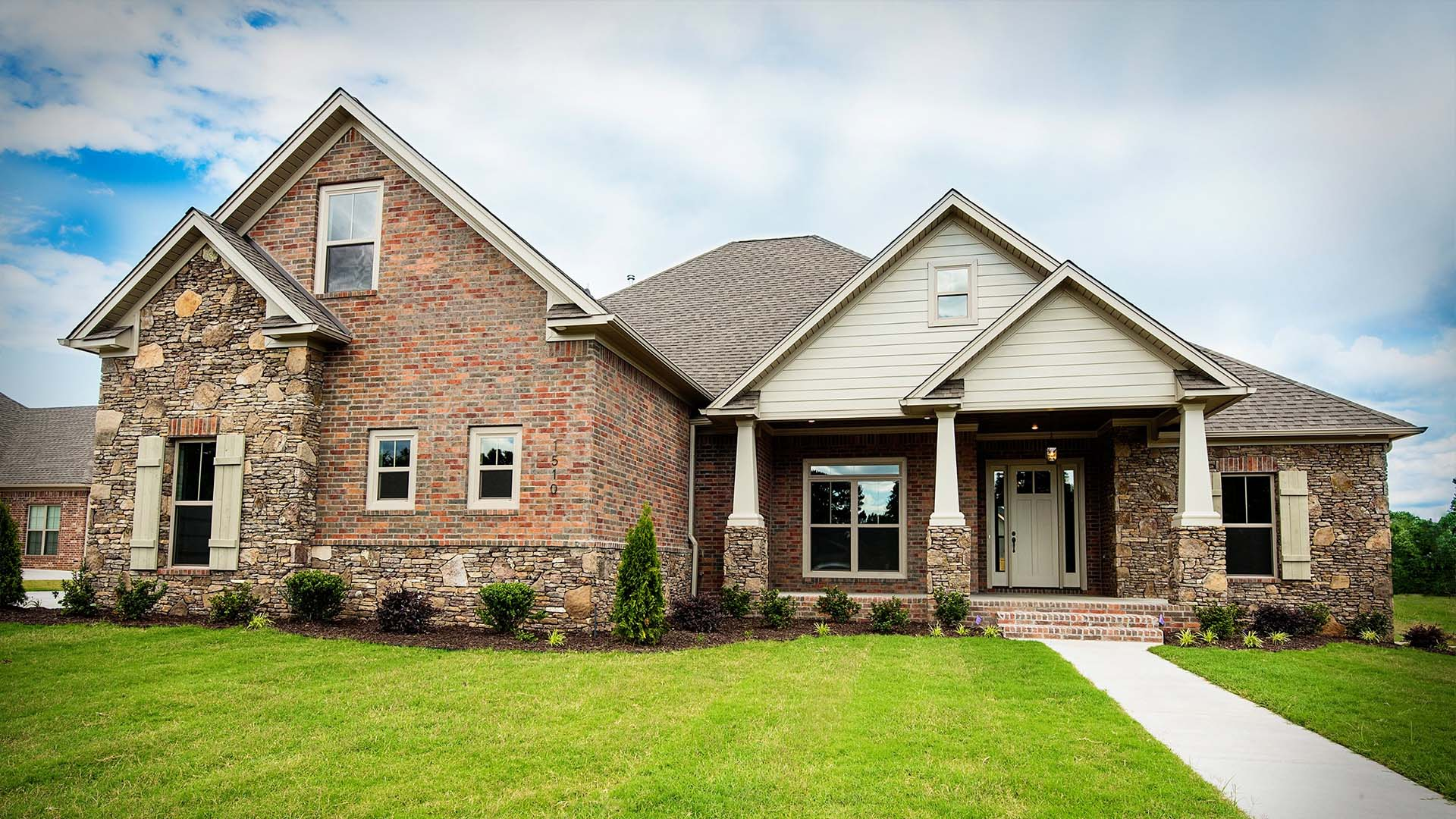 A Tom Watson Construction custom home with brick features